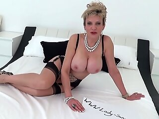 British MILF Sonia greases her meaty titties and plays