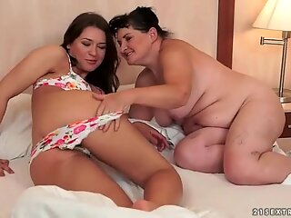 Sexy brunette and fat granny in hot lesbian action