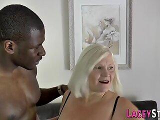 Busty granny riding black dick