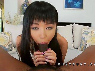 Asian babe sucks on giant black cock