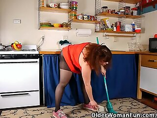 Chubby mom in pantyhose rubs pussy with dish brush